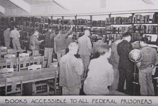 prisoners browsing books in prison library