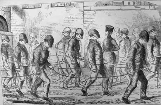 masked prisoners silently walking together